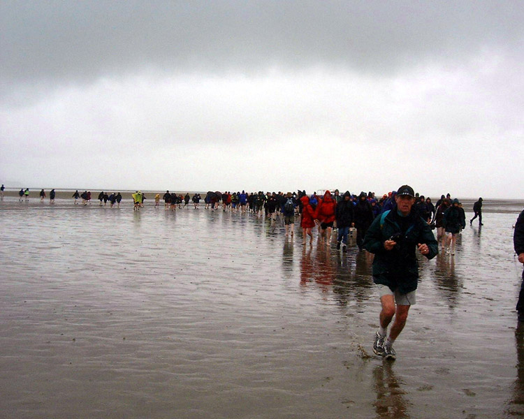 some 300 walkers on a Rotary Club event to raise cash for Polio Eradication are guided across the sands of Morecambe Bay by Cedric in June 2003